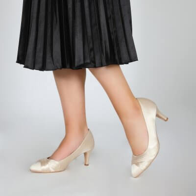 sally champagne satin criss cross vamp court shoes
